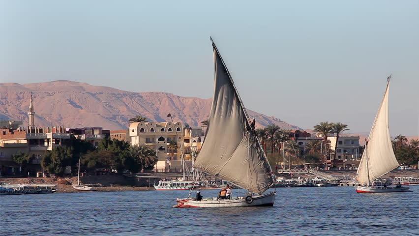 EGYPT, LUXOR - JANUARY 2013: Feluccas In Full Sail; River Nile Luxor Egypt
