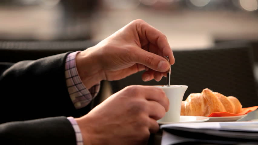 human hands to break with coffee and breakfast