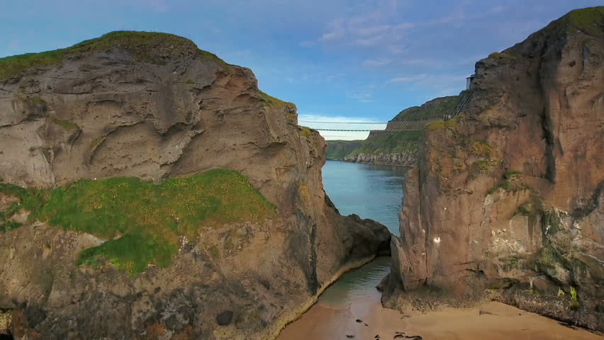 The Carrick-a-Rede Rope Bridge connecting two islands in North Ireland which is one of the tourists destinations in Ireland in Ireland