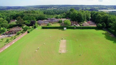Aerial/Drone footage of a countryside cricket match in England, UK. (4K)
