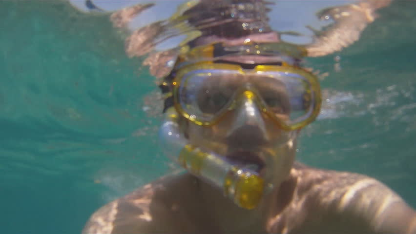 Man swims with the mask in the Red Sea