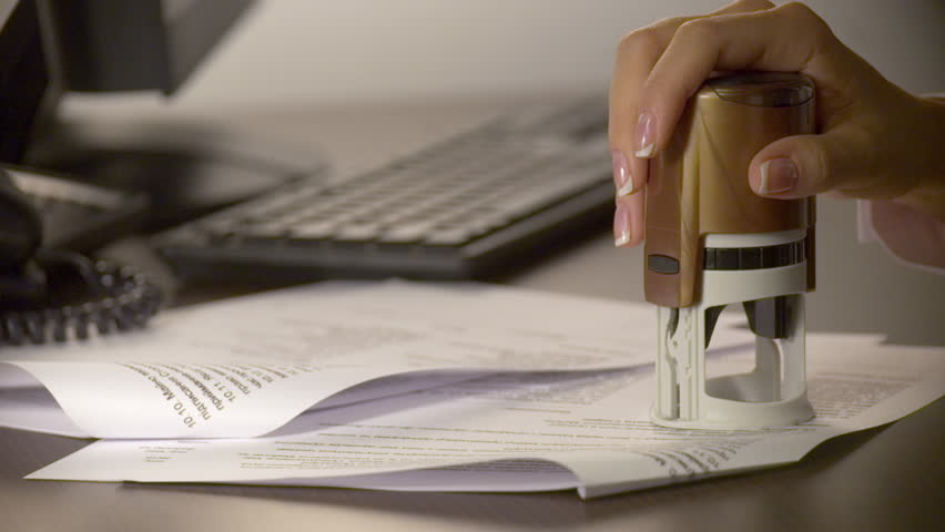 Businesswoman hand stamping the document | Shutterstock HD Video #22460341