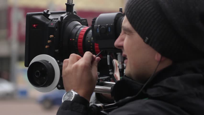 KYIV, UKRAINE - MARCH 7, 2015. Cameraman with a professional camera (close up) | Shutterstock HD Video #22460791