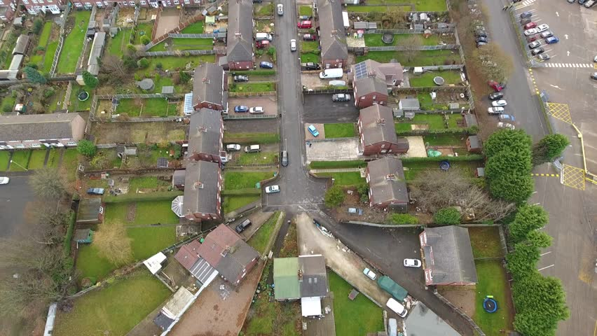 Tilting aerial view of a British street.