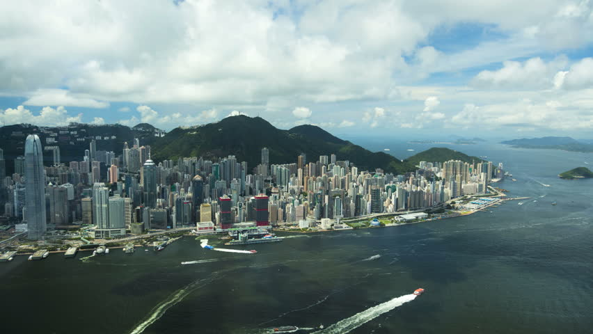 Hong Kong - September 2016: Time lapse Cloudscape Waterfront view of Victoria Peak Victoria Harbor modern city Skyscrapers Hong Kong Island China South East Asia | Shutterstock HD Video #22497037