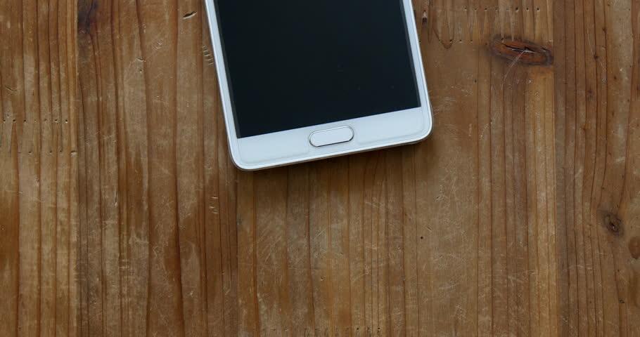 seoul south korea nov calling smart phone on wood desk this is
