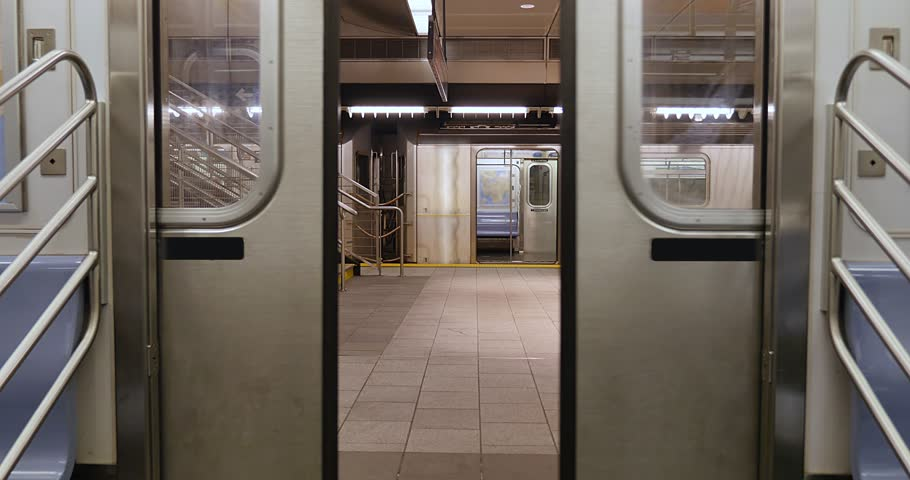 An interior view of the doors on a New York City subway car as they open at the platform.   | Shutterstock HD Video #22512283
