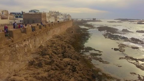 Morocco: Aerial view of the coast/cliffs and medina of Essaouira near Marrakech/Marrakesh in Morocco, Africa filmed by a drone 2/3