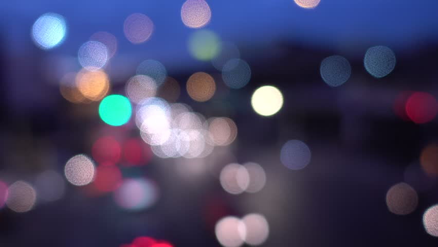 4K Bokeh of car lights. On the street at night Colorful Circles Video Background Loop Glassy circular shapes perform a colorful dance. motion background that events Car Lights - out of focus