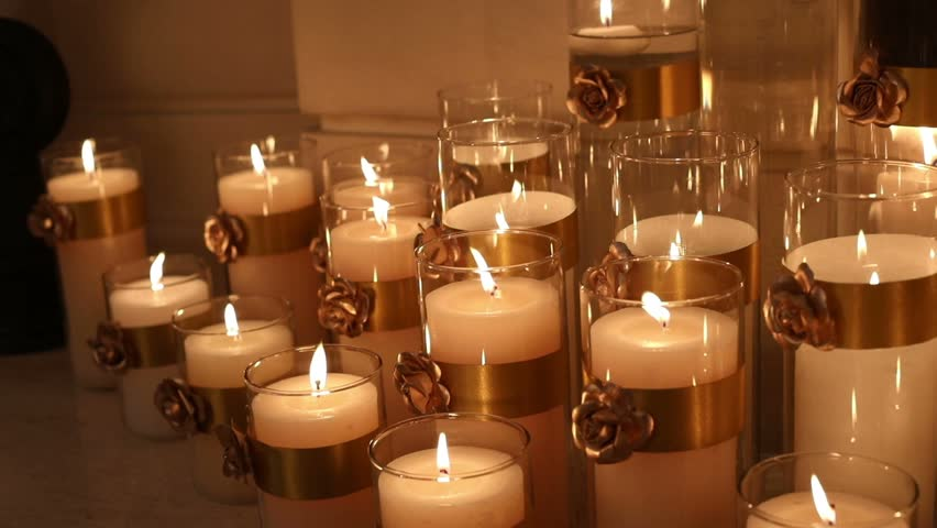 many candles burning decorative candle in a glass candlestick large wax candles are lit in the room shallow depth of field focus nobody - Candle Decoration