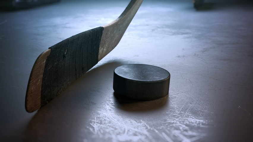 Close-up hockey stick hitting hockey puck in slow motion | Shutterstock HD Video #22580857