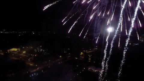 Aerial: St. Petersburg , Russia, fireworks over the city, flying inside a large firework