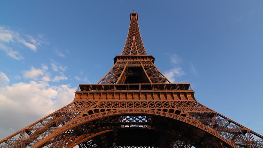Eiffel Tower. Timelapse. Wide angle timelapse view of Eiffel Tower in Paris, France. Clouds moving past. | Shutterstock HD Video #2263868