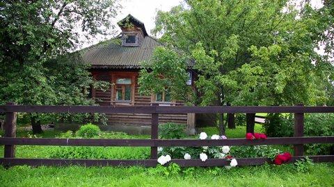 Exterior of wooden russian house. Beautiful bright sun, peaceful scene.
