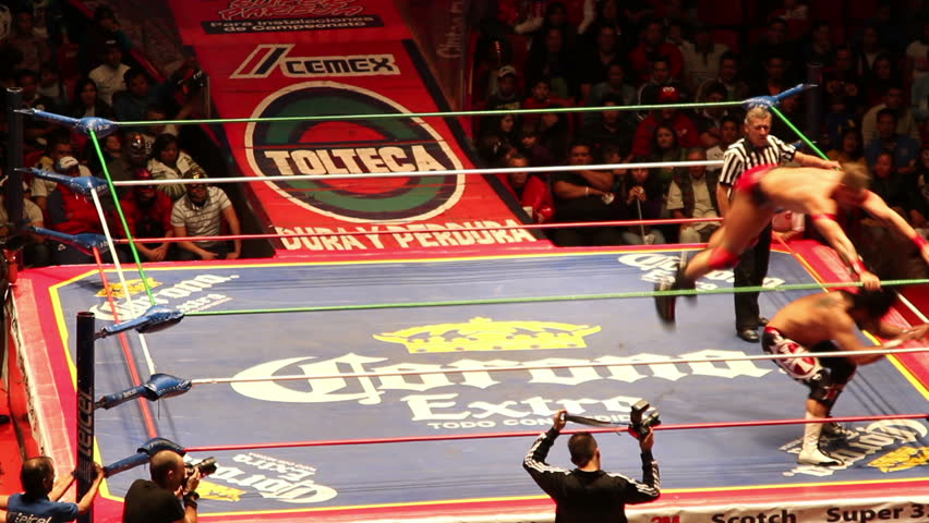 MEXICO CITY - DECEMBER 19: Ringside view of a lucha libre, famous mexican wrestling competition at Arena Mexico on DECEMBER 19, 2011 in Mexico City, Mexico.
