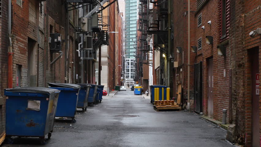 A daytime overcast establishing shot of an empty alley in a big city.	 	 #22676722