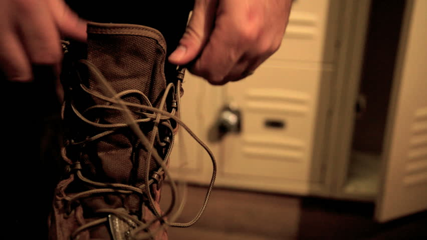 close up of pilot lacing up boots