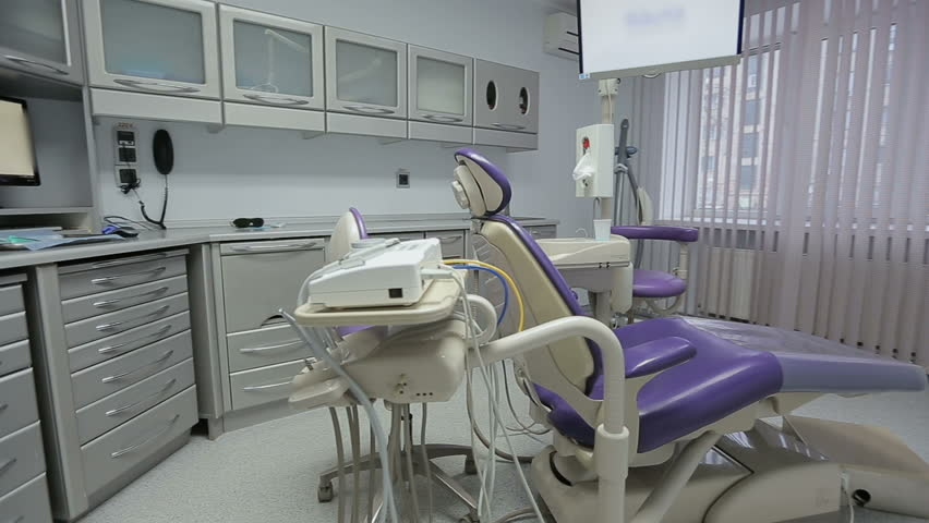 Modern Dentist / State of the art dentist office with modern equipment and technology is empty and ready for work.