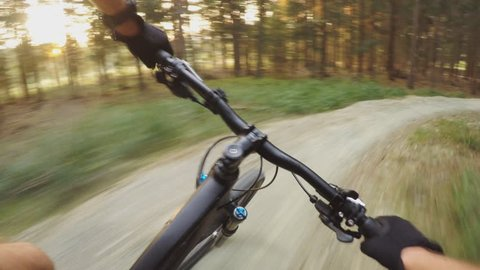 MTB bike riding on enduro mountain track trail in autumn forest. Mountain biking downhill in woods. View from first person perspective POV. Gimbal stabilized video.