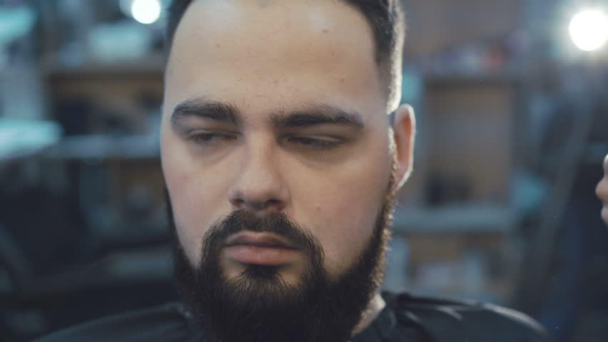 Female barber scratching the male beard hair with brush 4K | Shutterstock HD Video #22709851