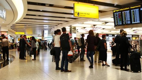 LONDON, UK - SEPTEMBER 29, 2016: A lot of people at duty free shops at Heathrow airport on September the 29th, 2016 in London, England, uk. Heathrow is one of the busiest airports in the world