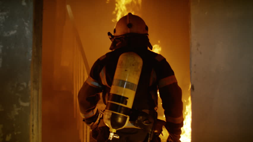 Two Brave Firefighters Go Up Burning Stairs. They Go Through Open Doors. Building is on Fire. Open Flames and Smoke Everywhere. Slow Motion.  Shot on RED EPIC 4K (UHD).