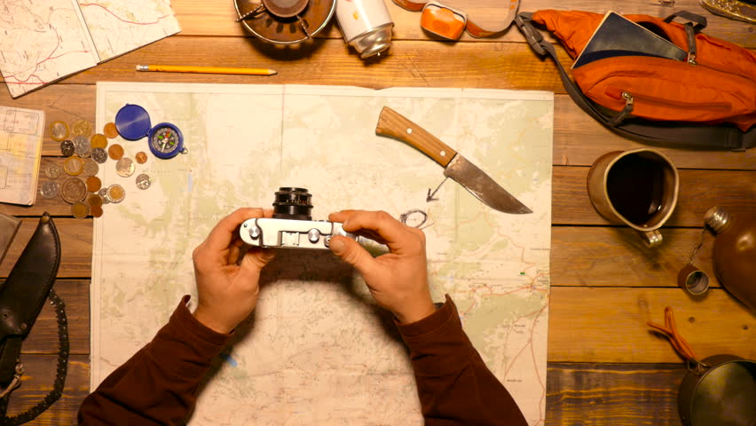 Traveler holding in hands and testing old photo camera. Top view. | Shutterstock HD Video #22789681