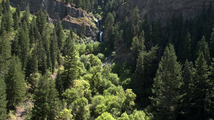 Rising view of green mountain side with waterfall. | Shutterstock HD Video #22827541