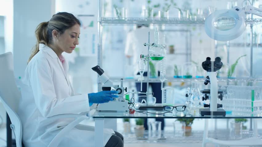 4K Research scientists studying plant life in laboratory Dec 2016-UK #22857151