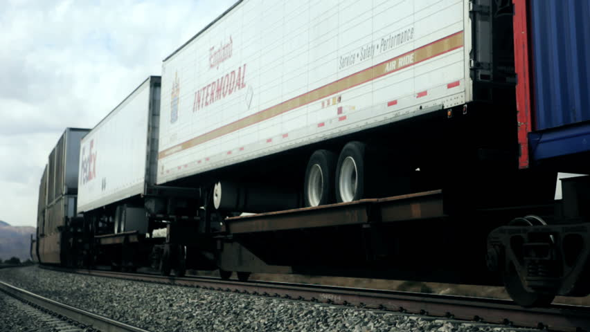 Los Angeles - Circa 2009: Moving freight train in Southern California in 2009. Freight train carrying storage containers through Southern California.