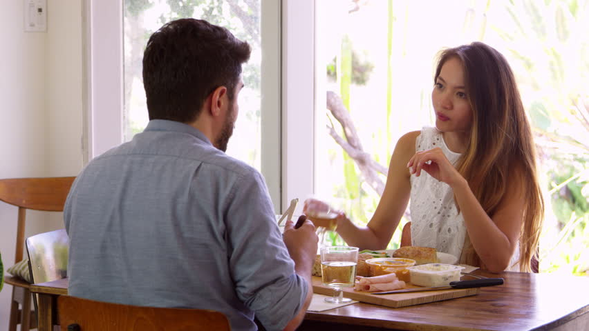 Couple Enjoying Meal At Home Together Shot In Slow Motion | Shutterstock HD Video #22923091