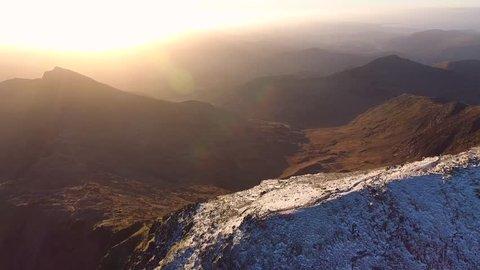 Panning aerial shot of Mount Snowdon, UK.