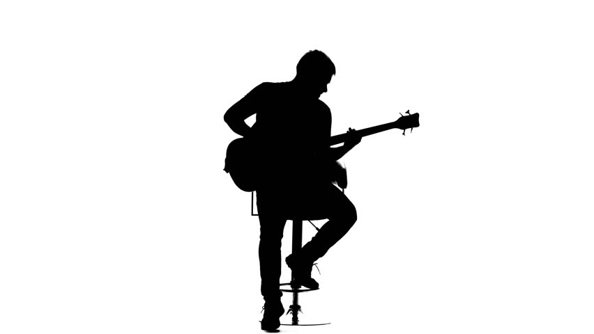 Silhouette Of Sitting Man Playing The Guitar On White ...