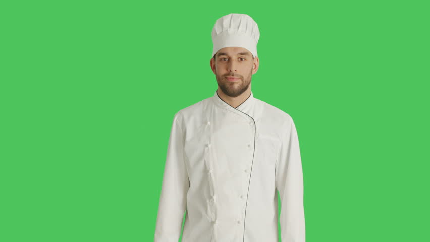 Mid Shot of a Handsomer Chef Crossing His Arms and Smiling. Background is Green Screen. Shot on RED Cinema Camera 4K (UHD).