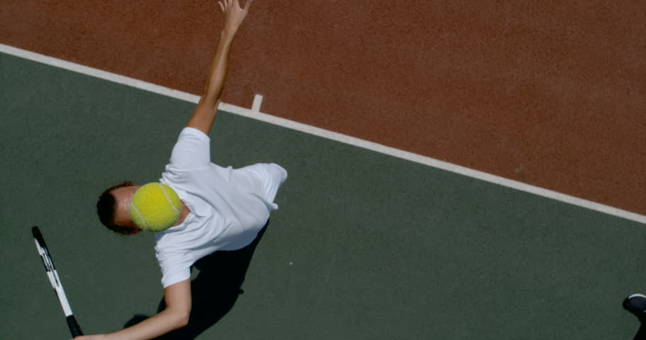 4K Overhead view in super slow motion tennis player hitting the ball during game Dec 2016-UK