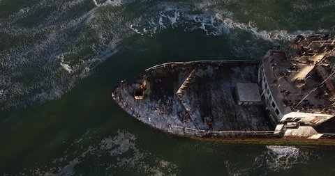 Aerial view drone video of Namibian Atlantic coastline, Zeila L-758  Walvis Bay shipwreck and sand beach, surf break line, Skeleton Coast Park landscape with ocean background at Namibia's west coast
