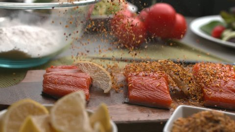 Seasoning falling onto Salmon fish in super slow motion, shot on Phantom Flex 4K