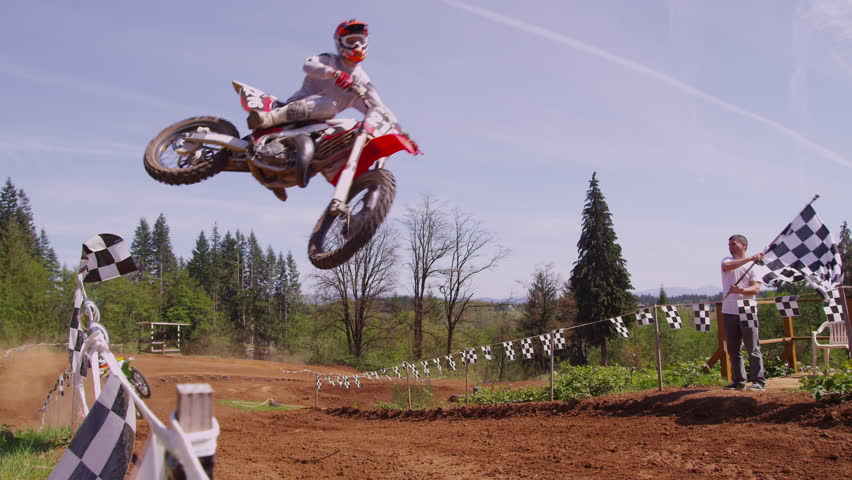 Motocross racers going over big jump in slow motion 4K (fully released)
