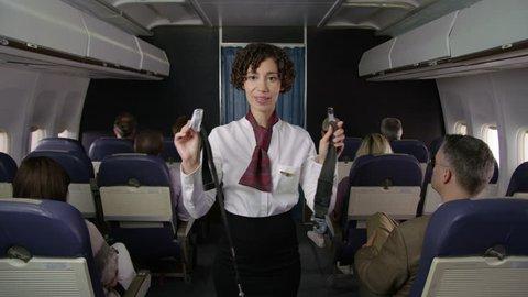 Airliner flight attendant explaining saftey rules