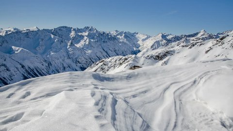 Sunny Winter Day in Snowy Alps Mountain in Solden Valley Time Lapse. Dolly Shot over Snowdrift