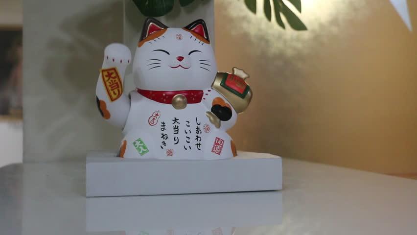 Maneki-neko Lucky Charm Cat on a table