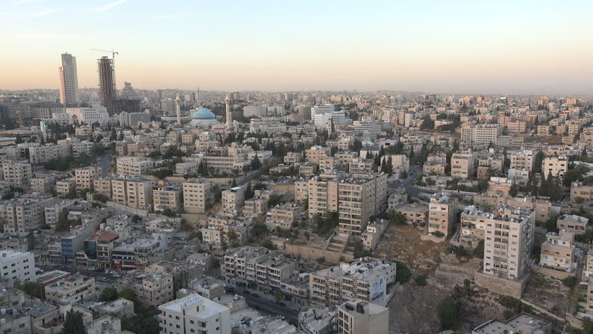 AMMAN, JORDAN - NOVEMBER 2016: Modern skyline of Amman with various office towers, construction sites, and the imposing King Abdullah mosque | Shutterstock HD Video #23119681