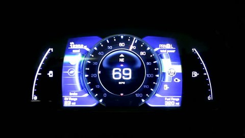 Modern light car mileage (dashboard, milage) isolated on a black background. New display of a modern car. Futuristic.