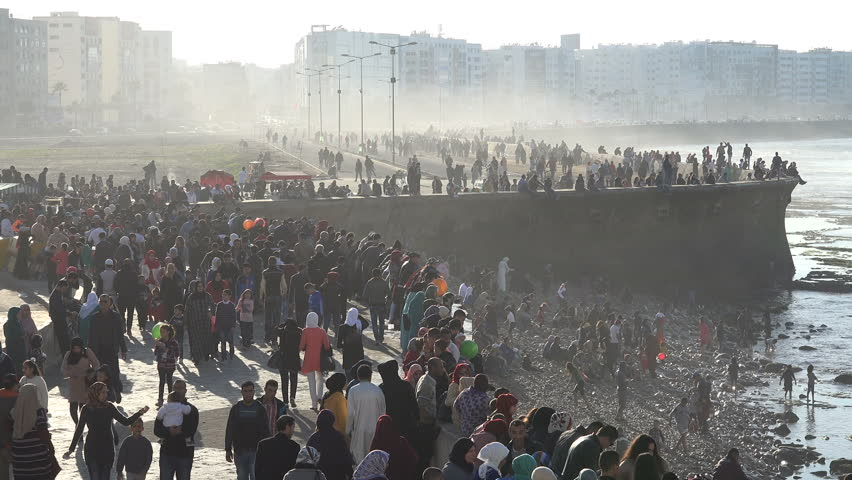 CASABLANCA, MOROCCO - DECEMBER 2016: Thin mist rolls in on a popular boulevard where crowds of people have gathered to celebrate a holiday in Casablanca, Morocco
