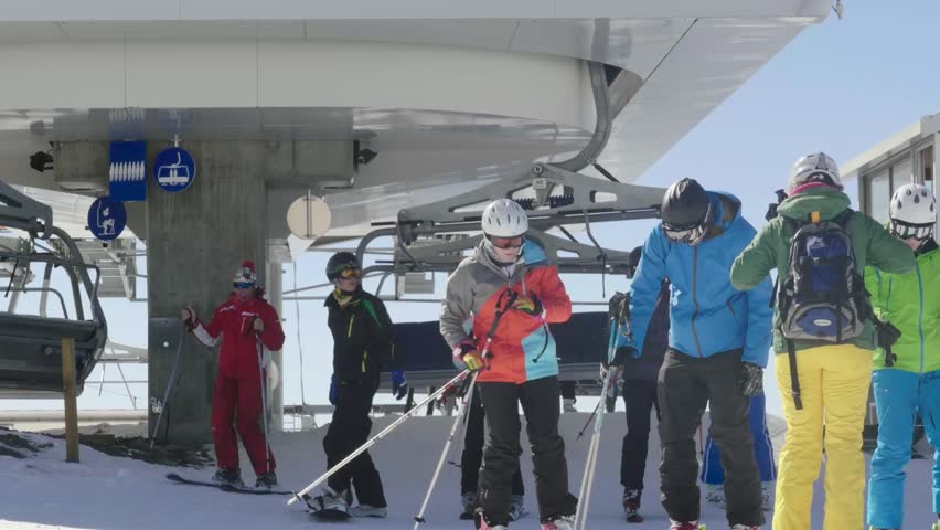 Ajax, France, dec 2012: Skiers who came with chairlift on the piste and is now preparing to descend the slopes of the mountain slanted 33p1  | Shutterstock HD Video #23177827