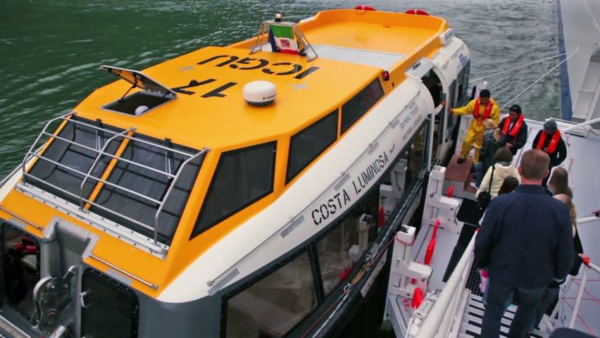 GEIRANGER - JUNE 28: Several passengers come to board of transport vessel on JUNE 28, 2011 in Gieranger, Norway. | Shutterstock HD Video #2318111