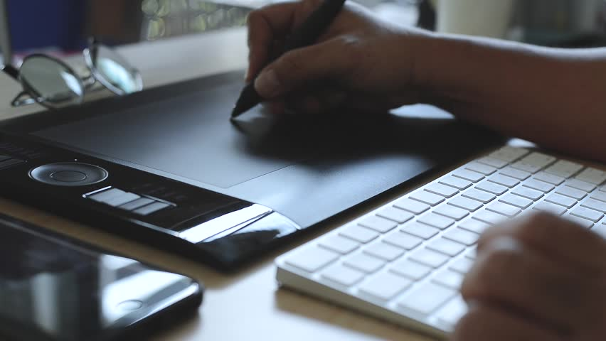 Designer working with graphics tablet, hands of a man working with drawing tablet for a computer, Soft focus shot(HD, high definition 1080p) | Shutterstock HD Video #23214421