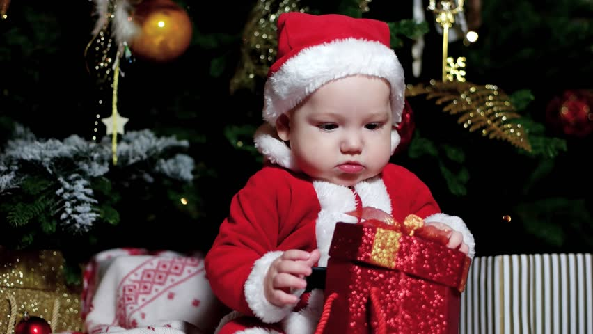 f58eff220e6c Little Baby Dressed in Santa Stock Footage Video (100% Royalty-free ...