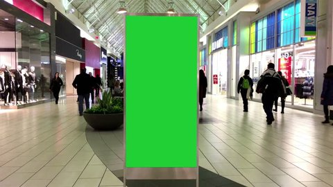Coquitlam, BC, Canada - January 18, 2017 : Green billboard for your ad inside Coquitlam shopping mall with 4k resolution