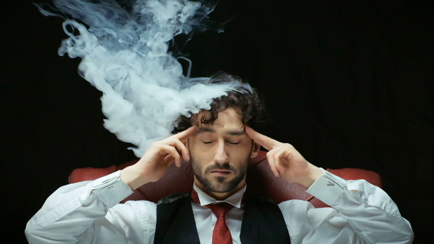 Stress with businessman and smoke in head | Shutterstock HD Video #23352901
